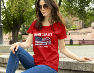 Home of Brave - Land of the Free T-Shirt on Sitting Girl
